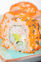 Closeup California maki sushi with masago