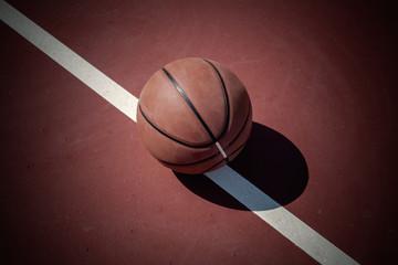 Closeup basketball ball on outdoor court