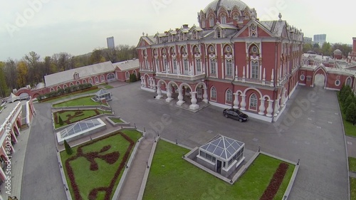 poster of Black car stands near edifice of Petrovsky Travelling Palace