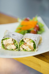 steamed salmon and salad wrap