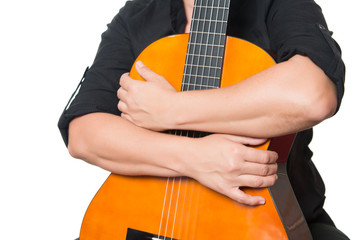 Arms hugging an acoustic guitar