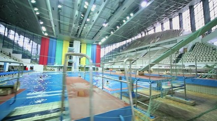 Net in pool where sportsmen prepares to match on water polo