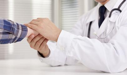 Doctor reassuring his female patient