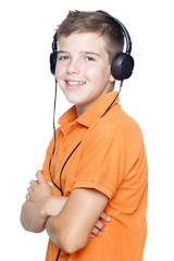 Smiling boy in headphones listening to music, isolated on white