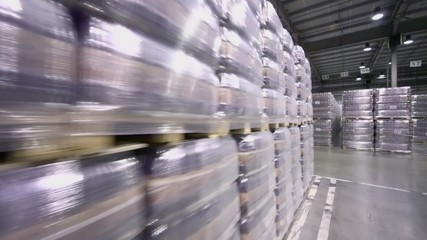Lot of stacks with packaged beer in warehouse of brewery factory