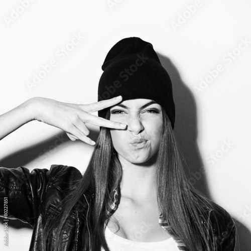 faf7777c73f Hipster teenage girl with black beanie hat posing