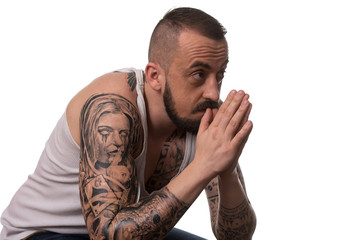 Man With Tattoo And Beard On White Background