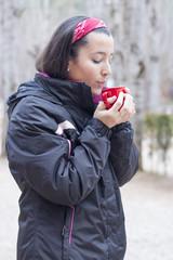 Woman driking coffee at nature