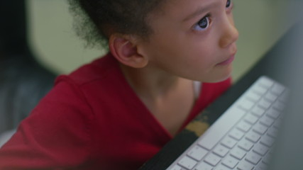 Young girl playing on a computer