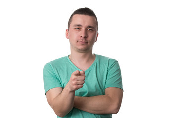 Casual Young Man Pointing A Finger Towards Camera