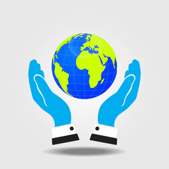 Hands of businessman holding a green earth.