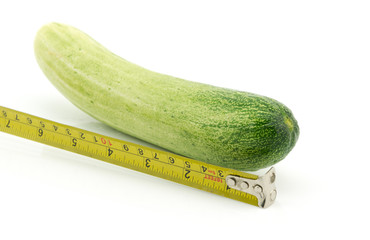 Long cucumber and measuring tape