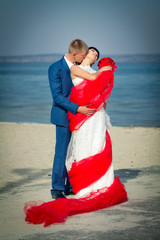 the groom and the bride on a beach