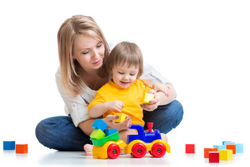 kid with his mom play building blocks toys