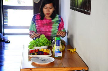 Woman with meal time vegetable and fruit Salad.