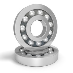 Two shiny steel ball bearings on a white background
