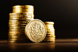 pound GBP coin and gold money on the desk - 80233489