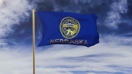 nebraska flag with title waving in the wind. Looping sun rises