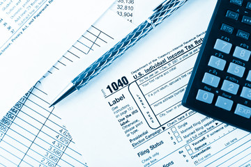 income tax return with pen and calculator