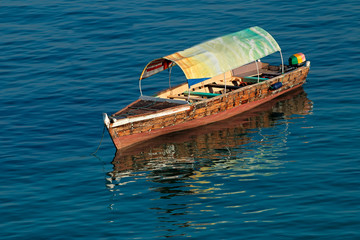Wooden boat on water, Zanzibar