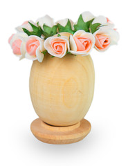 Wreath of flowers on a wooden egg isolated on white background