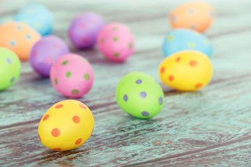 Pastel Easter eggs on vintage green