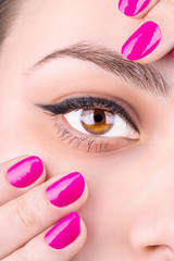 Female eye and manicure