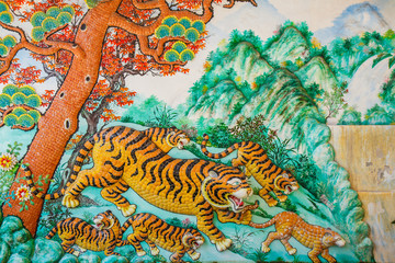 Tiger statue on the wall of a Chinese temple.