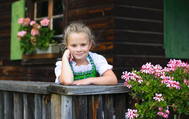 Portrait of little girl wearing a traditional Bavarian dress