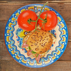 Sandwich with tomatoes on a plate