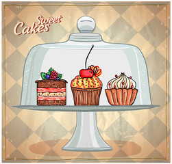 Set of cute cakes under glass dome.