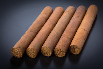 Cuban cigars on black background