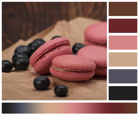 Macaroon Biscuits, Blueberries On Paper. Wooden Table. Palette W