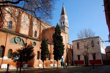 Venetian church courtyard in sunny day. Venice, Italy