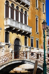 Typical venetian building, its windows and bridge. Venice, Italy