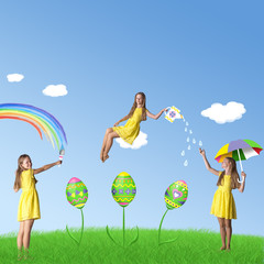 Happy Easter: girls in yellow and decorated eggs