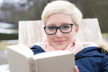 Friendly young Woman reading Book