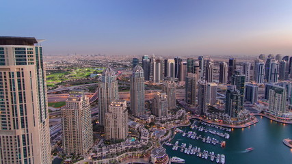 Dubai Marina with yachts day to night timelapse
