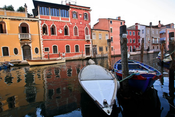 Boats on the canal of the old Italian city
