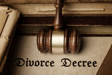 Divorce Decree surrounded by gavel and books