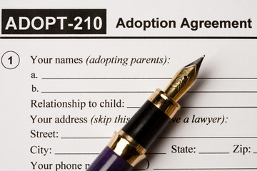 Adoption agreement form with fountain pen