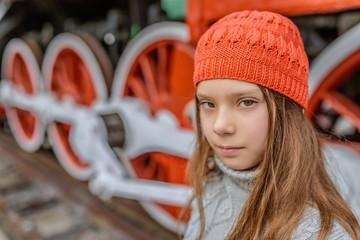 little girl near the old steam locomotive