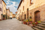 Beautiful and colorful streets of the small and historic Tuscan - 80243643