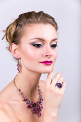woman with makeup. hair style. large ring and earrings