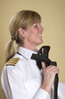 Female airline captain tying her necktie knot