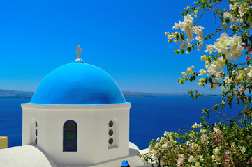 Beautiful blue dome church in Oia, Santorini, Cyclades, Greece