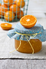 jar with tangerine jam on a linen napkin