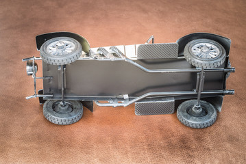 Leaned antique toy car