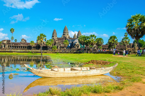 Papiers peints Ile Angkor Wat with old boat seen across the lake, Cambodia