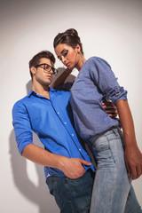 Angle view of a fashion couple embracing